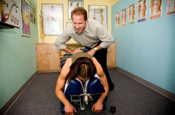 American chiropractor giving an adjustment