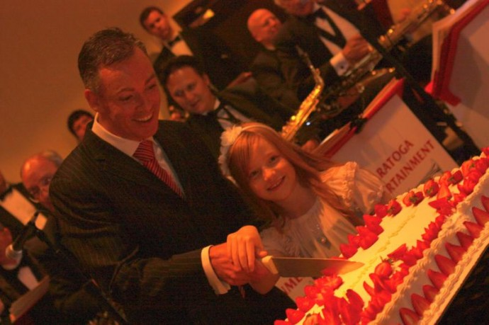 Brian Kelly Cutting Cake