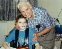 Dr. Moshe Gottlieb with a Down's patient he cared for.