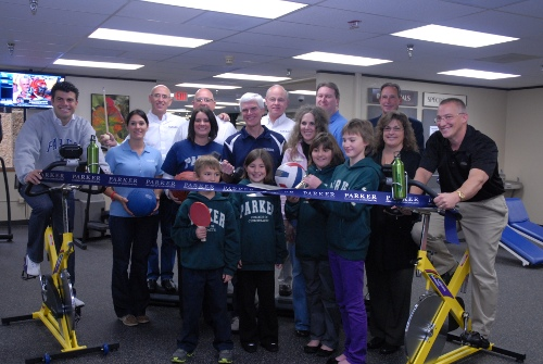 DuBois Family poses with Parker executives, staff, and students during Standard Process Student Activity Center opening