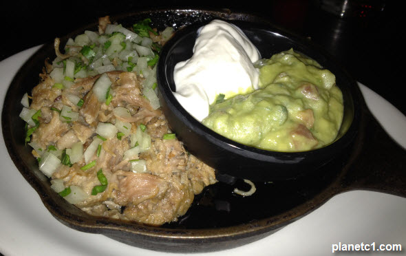 pork carnitas with guacamole and sour cream