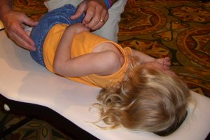 Child on Chiropractors Adjusting Table