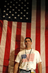 Gary DiBenedetto, D.C. in front of flag