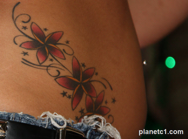 girls belly tattoo flowers