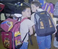 Kids show off their new backpacks