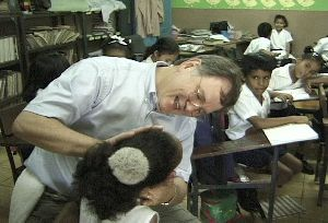 Dr. Jim Stucky adjusts a child inside the classroom
